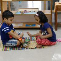 Children exploring Montessori Materials