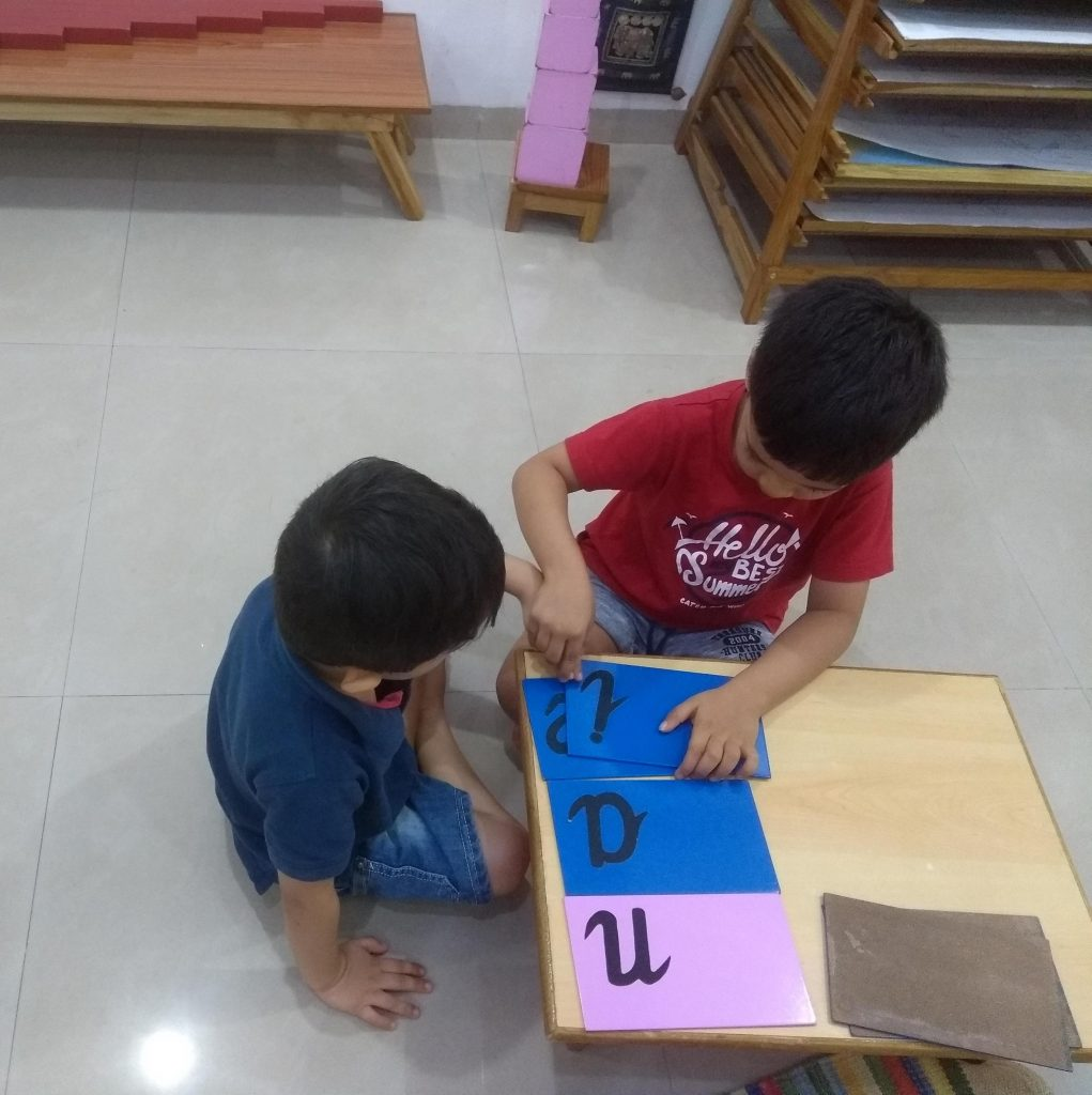 4 year old teaching 2 year old