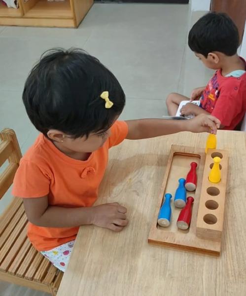 Children at Savi Montessori engaging with the materials