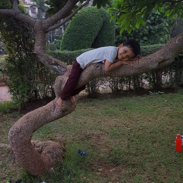Rian hugging the Tree he climbed (: