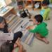 Juie working with Savi Montessori children on wild animals